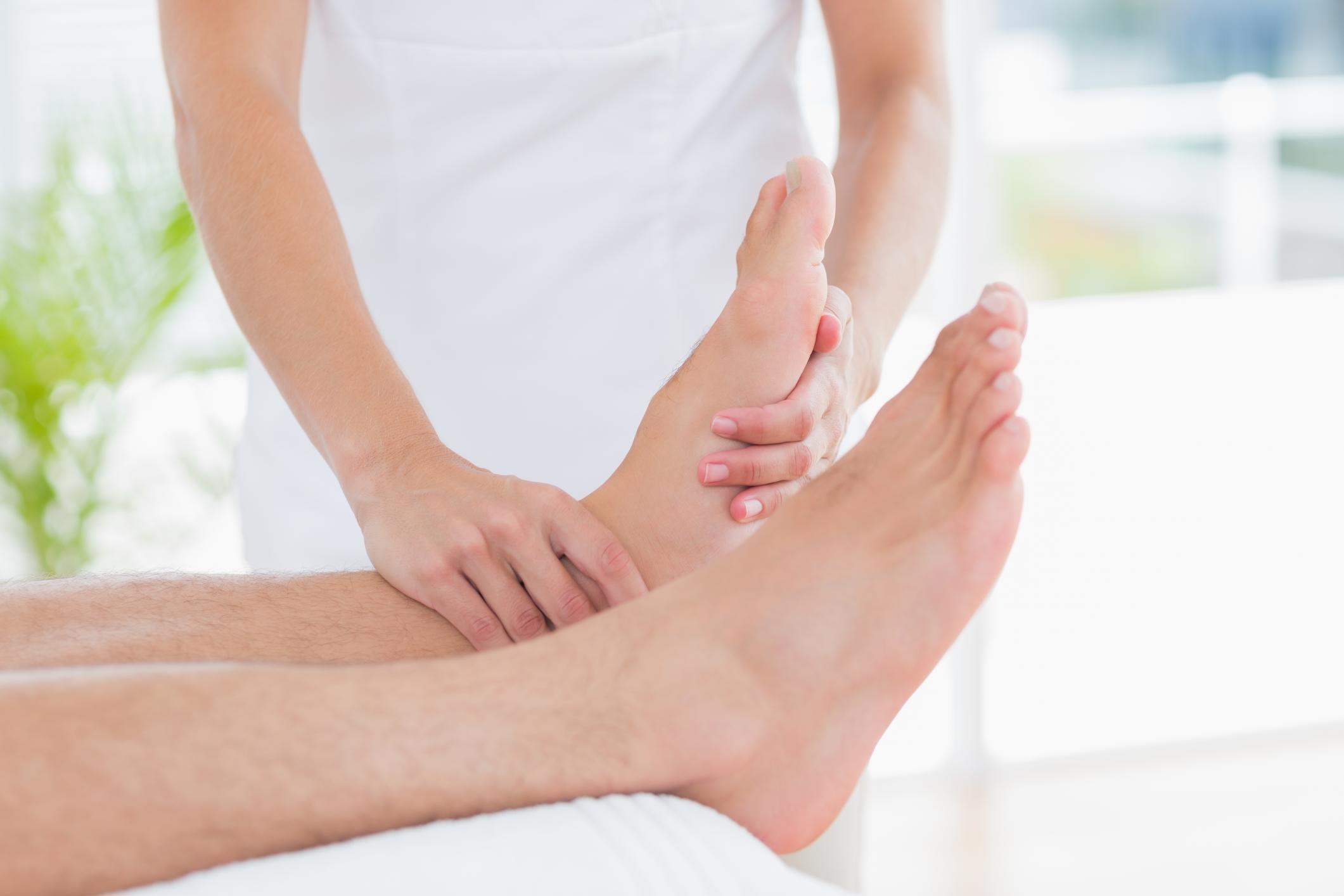 Massage therapist massaging feet