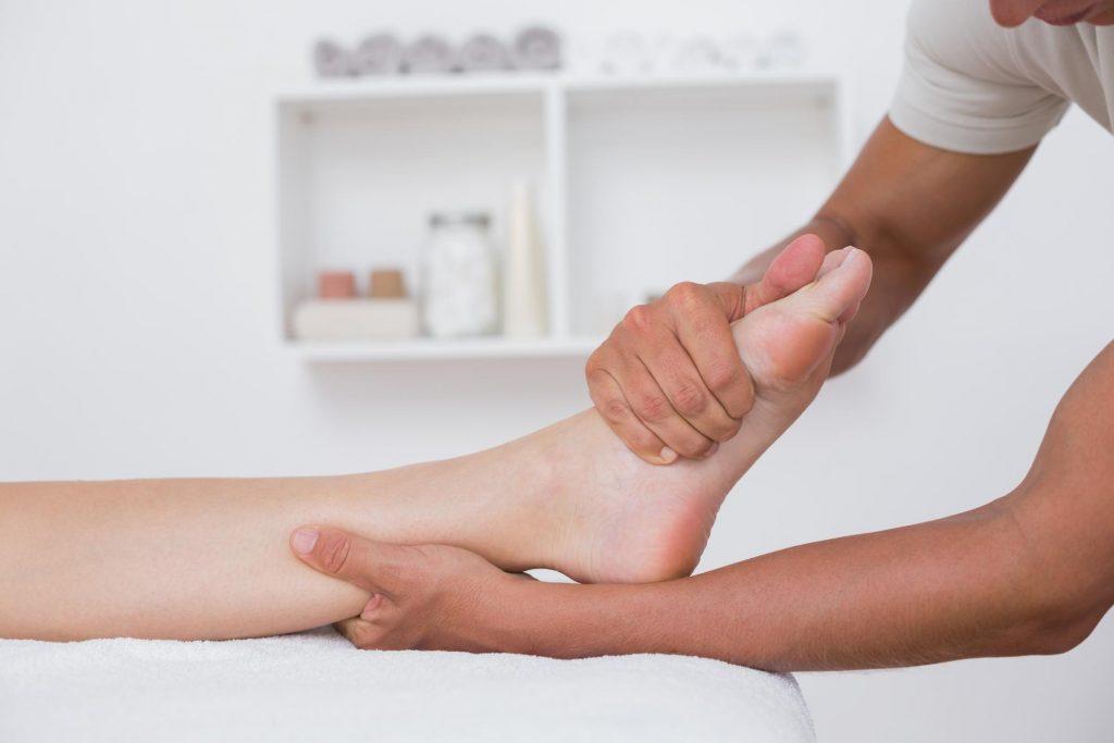 Massage therapist massaging a foot