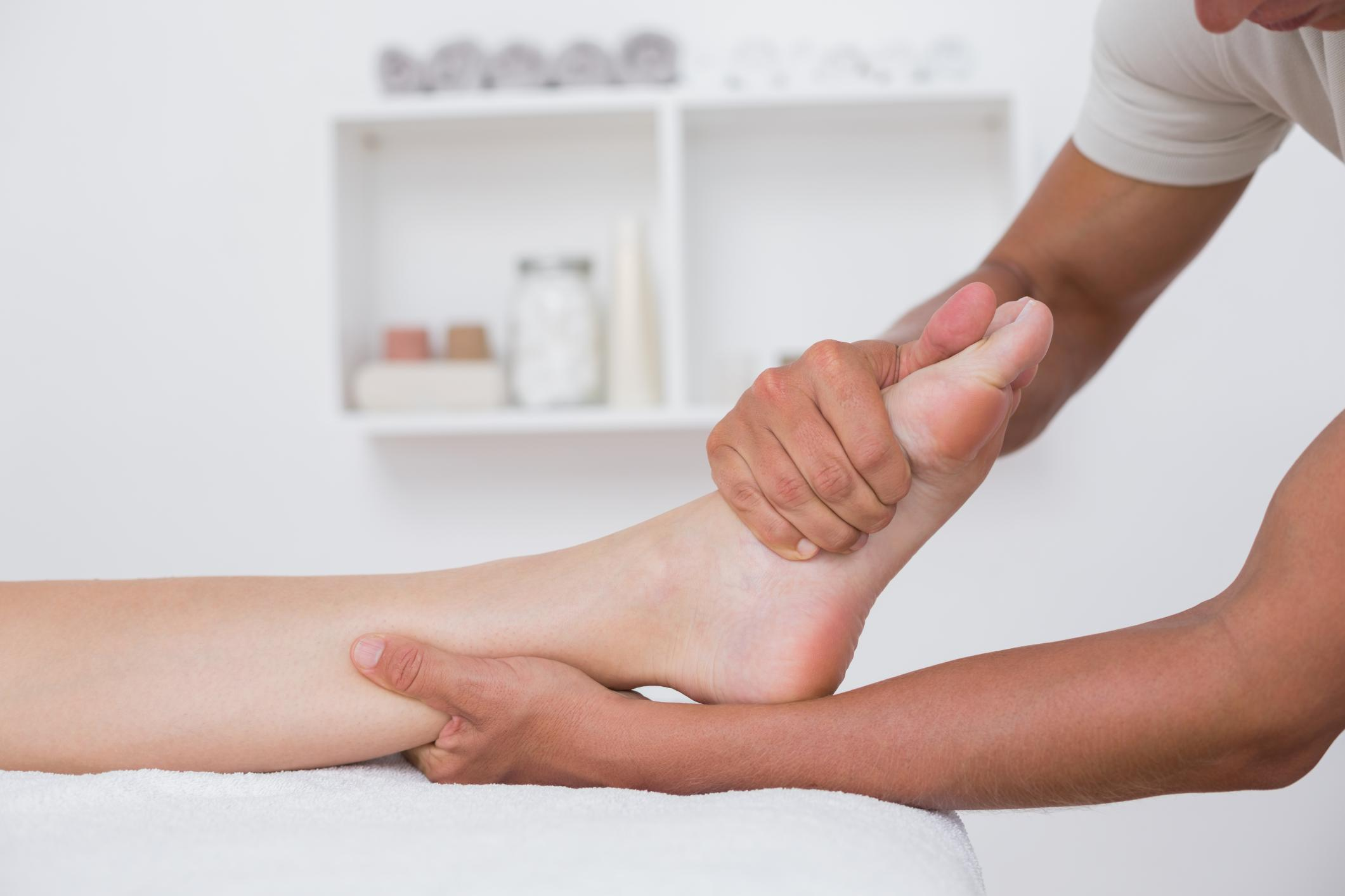 Massage therapist massaging a foot